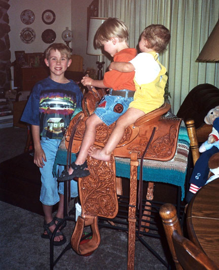 kids on the saddle