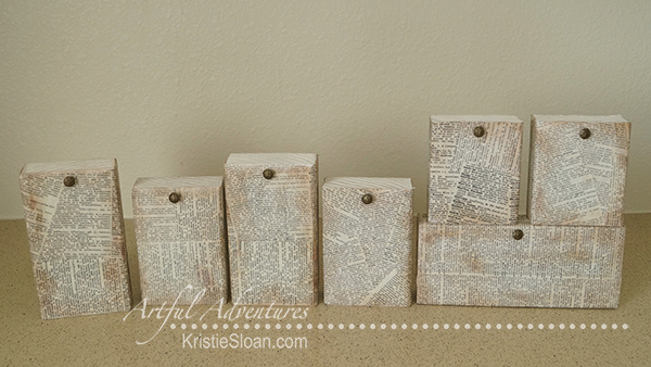Each individual block hangs a tag with a letter or decorative element.