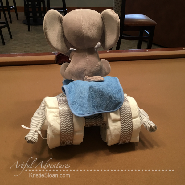 artful adventure baby shower kristie sloan diaper tricycle back