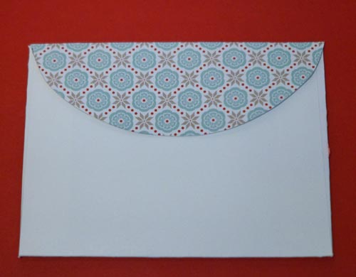 Adhered matching paper to the back curved flap.