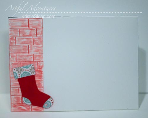 Brick and Christmas stocking on envelope