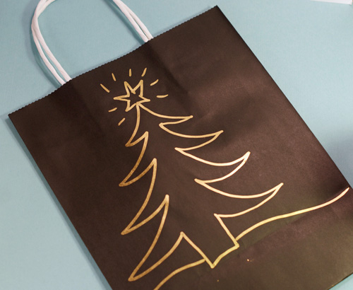 hand decorated gift bag with Christmas tree