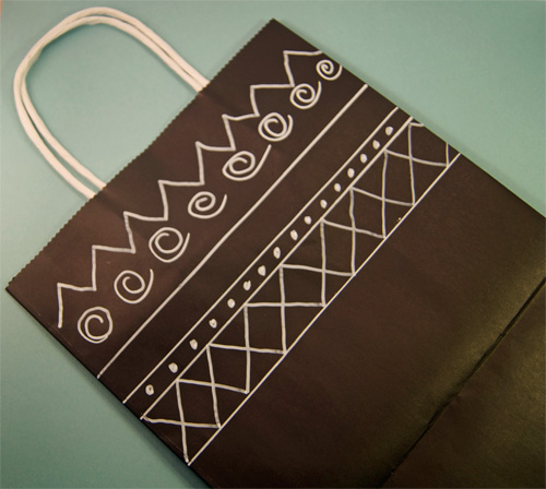 hand decorated black gift bag with simple white marker.
