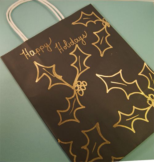 decorative gift bag with holly and berries