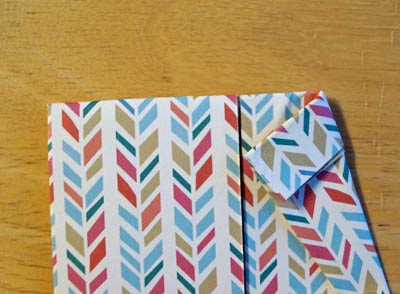 create collar by folding edge toward center