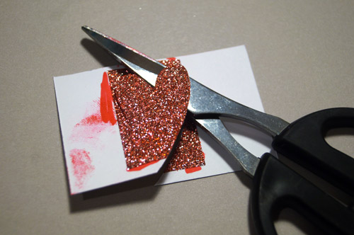 Cut heart out of tinted shimmer trim.