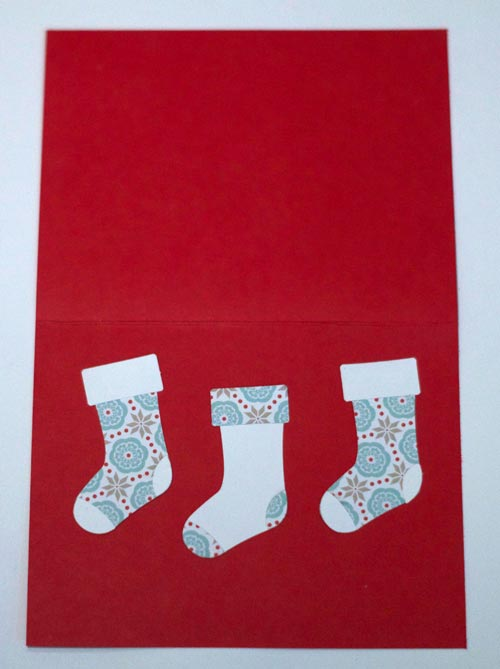 Card base and three Christmas stockings