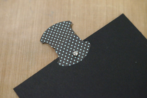 Place the brad before folding the tab to the cover the second side.