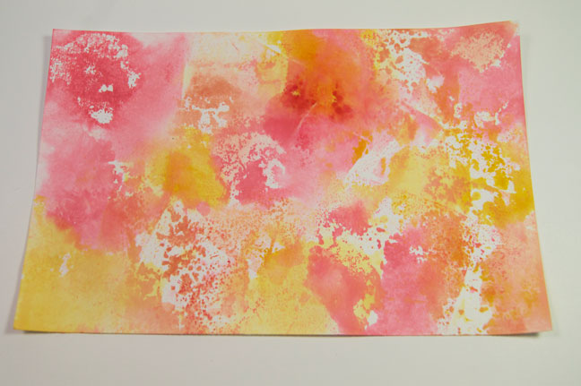 Stamp the ink from the acrylic block randomly on the paper, changing colors as desired